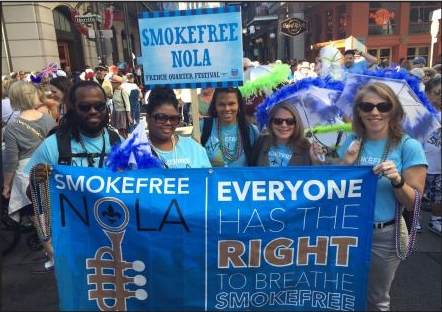 Photo of smokefree advocaates celebrating a smokefree New Orleans